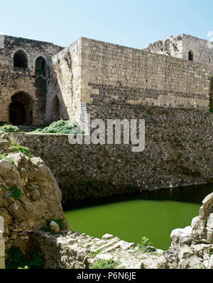 Syria. Talkalakh District, Krak des Chevaliers. Crusader castle, under control of the Knights Hospitaller (1142-1271) during the Crusades to the Holy Land, fell into Arab control in 13th century. View of the moat. Photo  taken before the Syrian Civil War. - Stock Image