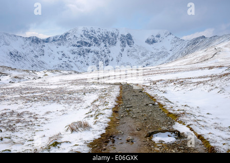 Footpath to Red Tarn and Helvellyn with Swirral and Striding Edge in mountains of Lake District National Park Cumbria England UK - Stock Image