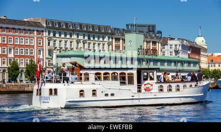 Tourist boat in front of the Standard, Copenhagen harbour, Denmark - Stock Image
