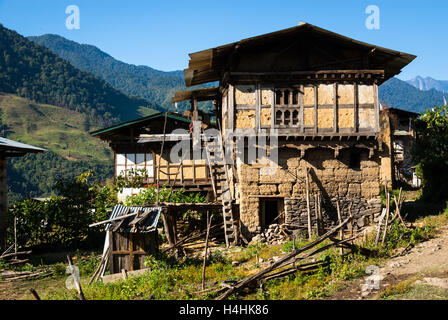 Traditional rammed-earth and wood houses in remote Nabji Village, which lies in the hills south of Trongsa, Bhutan - Stock Image