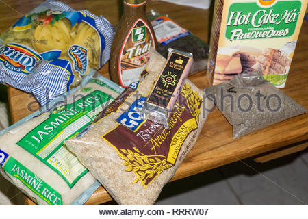 An expat's supermarket shopping haul shows both Nicaraguan packaged foods, including chia seed,  and imported rice varieties and Thai sauce. - Stock Image