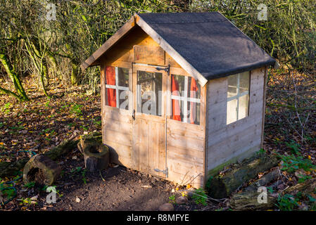 Wooden garden shed outdoor children playhouse - Stock Image