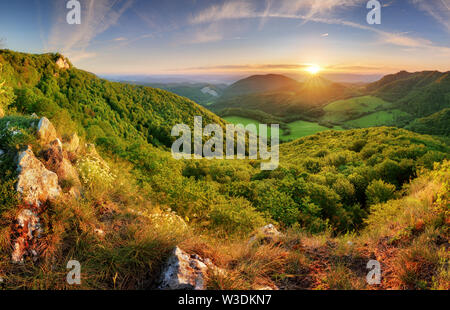 Majestic sunset in the mountains landscape - Stock Image