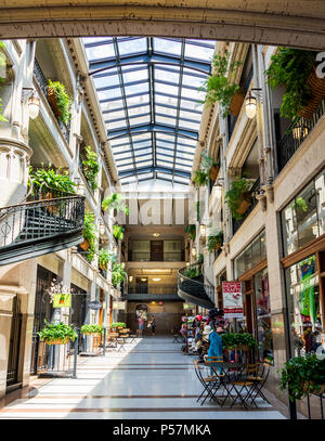 ASHEVILLE, NC, USA-24 JUNE 18: A hallway inside the Grove Arcade, featuring a variety of small shops. - Stock Image