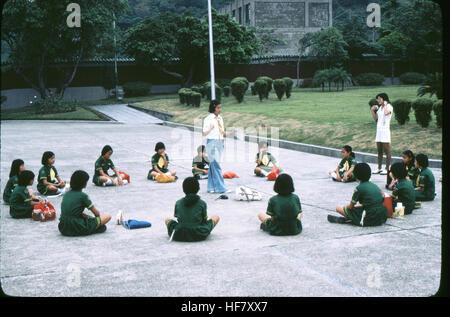 Children being taught at National Shrine; Taipei, Taiwan. - Stock Image