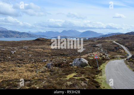 Single-track road with distant view of Loch Torridon and the Torridon Mountains, Applecross Peninsula, Wester Ross, Highland Region, Scotland - Stock Image