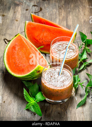 Watermelon mint smoothie. On a wooden background. - Stock Image