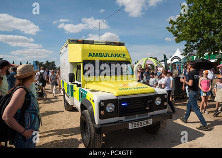 Woodstock, UK, 4th August 2018. Visitors flocked to BBC Countryfile Live, held within the grounds of Blenheim Palace. Animals, wildlife, food, outdoor sports, conservation, farming, rural affairs, entertainment, all were represented. Crowds make way for an emergency ambulance. Credit: Stephen Bell/Alamy Live News. - Stock Image