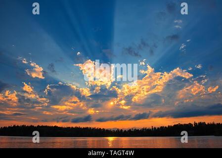 Crepuscular rays (God rays) on Star Lake Whiteshell Provincial Park Manitoba Canada - Stock Image