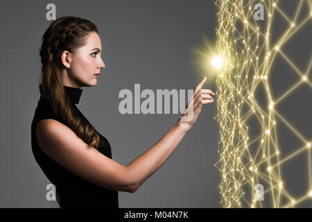 Young caucasian woman pointing wire mesh network concept. - Stock Image