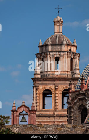The bell tower of the San Francisco Convent and the Aranzazu Chapel in the Plaza de Aranzazu in the state capital of San Luis Potosi, Mexico. The chapel and convent was built between 1749 and 1760 and features Churrigueresque details and tiled domes. - Stock Image