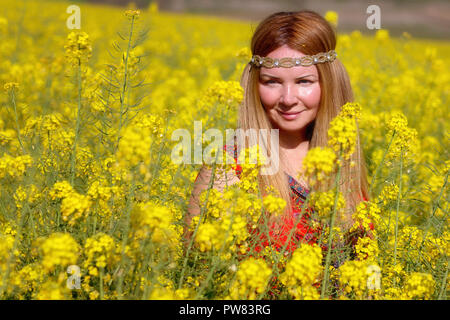 Lady in canola field - Stock Image