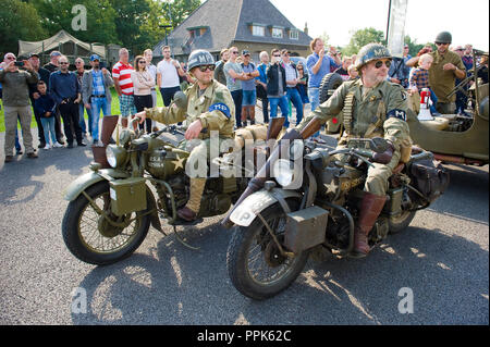 ENSCHEDE, THE NETHERLANDS - 01 SEPT, 2018: Two motorcycle's passing by during a military army show. - Stock Image