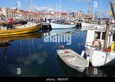Fishing boats in the marina and historical wharf buildings in the background, Constitution Dock, Hobart, Tasmania, Australia. No PR - Stock Image