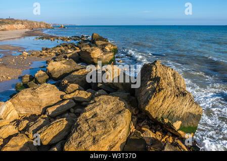 Big stones on the edge of the Black Sea. Autumn day by the sea near the village of Fontanka, Odessa region, Ukraine - Stock Image