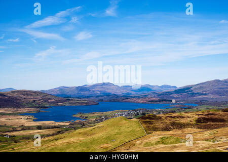 View to Llyn Trawsfynydd lake and village in Snowdonia National Park with mountains in distance to north. Trawsfynydd, - Stock Image