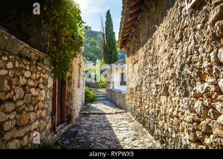 A narrow stone pathway in the medieval city of Pocitelj Capljina in Bosnia and Herzegovina - Stock Image