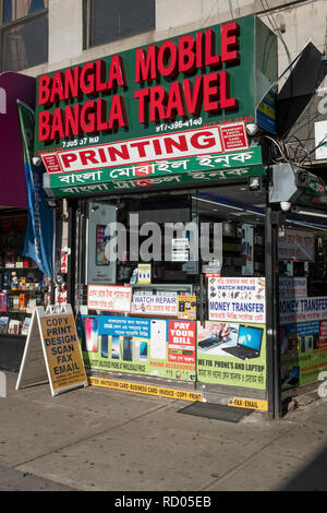 The exterior of Bangla Mobile Bangla Travel, a multi purpose store on 37th Road in Jackson Heights, Queens, New York City. - Stock Image