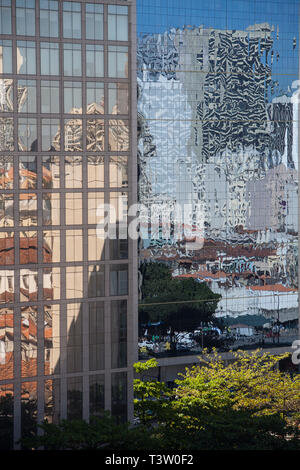 Urban abstraction, reflection of the city on glass business building in Rio de Janeiro downtown, Brazil. - Stock Image