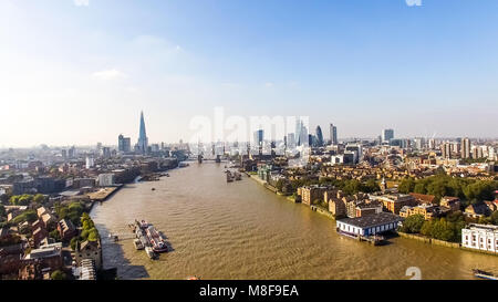 London City Skyline Aerial View feat. Famous Iconic Landmarks Skyscrapers Flying Over Thames River and Tower Bridge - Stock Image