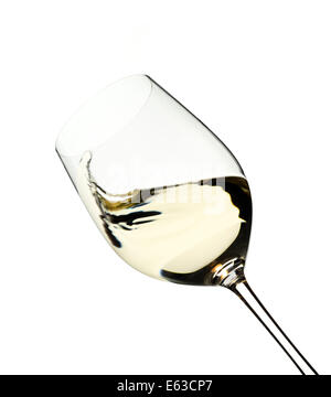 Swirl of white wine in a glass, on a pure white backkground - Stock Image