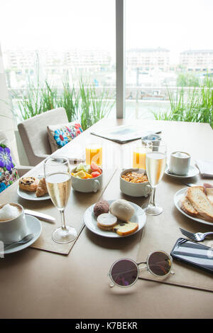 Breakfast on table in hotel - Stock Image