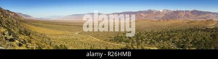 Wide Panoramic Landscape View of Owens Valley and US Plains from Alabama Hills east of Sierra Nevada Mountains above Lone Pine California - Stock Image