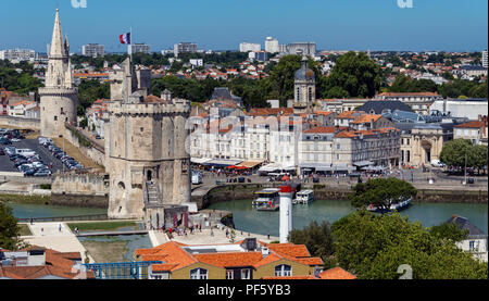 High level view of the port of La Rochelle on the coast of the Poitou-Charentes region of France. The tower with the flag is the Tour de la Chaine whi - Stock Image