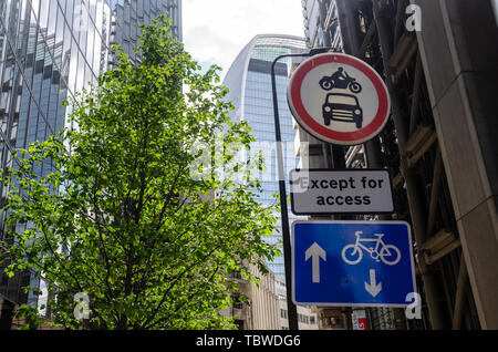 Road signs detail traffic restrictions on Lime Street in the financial district of London, UK - Stock Image