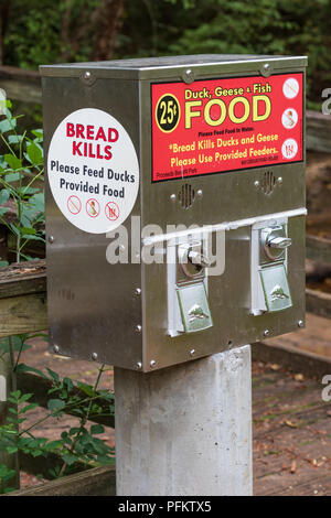HICKORY, NC, USA-21 AUG 2018: Duck and geese food dispenser at city park, warning against feeding bread to waterfowl. - Stock Image