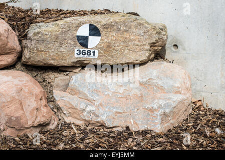 Survey Marker on University Outdoor Landscaping - Stock Image