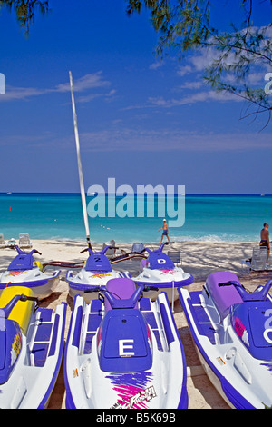 Jet Ski personal watercraft JetSki, Freestyle runabout lined on the beach in Georgetown Cayman Islands aqua ocean - Stock Image