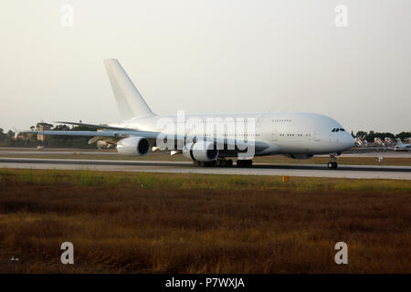 Intercontinental air travel. Airbus A380 long haul passenger jet plane on arrival. No livery, markings or proprietary details visible. - Stock Image