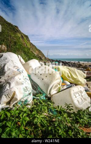 Washed-up plastic litter on the North Wales coast, UK. - Stock Image