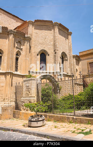 Italy Sicily Enna old mountain town 931m Cathedral Cattedrale detail rear stone arch ruin metal railings tree trees planter secluded cloudless - Stock Image
