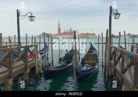 Docked gondolas in Venice Italy - Stock Image