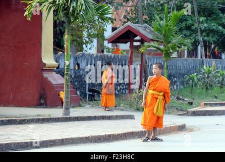 Lao novice monks in saffron robes Luang Prabang, Laos - Stock Image