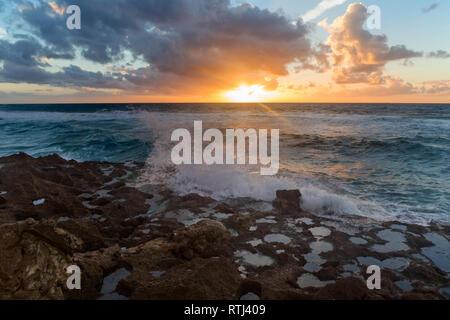 Sunset over ocean, Atlantic ocean shore, Cape Spartel near Tangier, Morocco - Stock Image