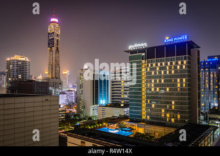 BANGKOK, THAILAND - NOVEMBER 2018: Bangkok lights at night from the roof of one of hotels - skyscrapers, windows and roof pool in Thailand - Stock Image