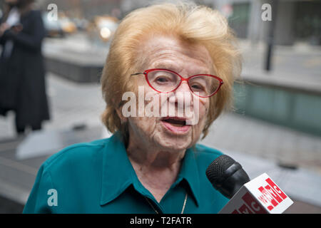 Dr. Ruth Westheimer, a Holocaust survivor, being interiewed on the plaza in front of the Museum of Jewish Heritage in Battery Park City where a German - Stock Image