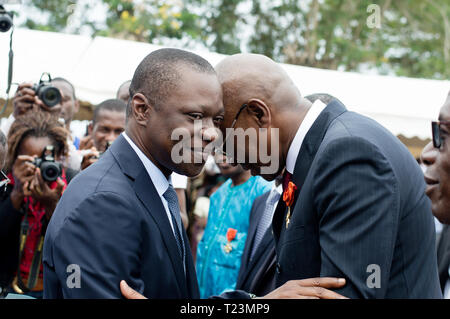 Abidjan, Ivory Coast - August 3, 2017: Greeting and accolade between sponsor, and invited to the end-of-cycle ceremony of marine students - Stock Image