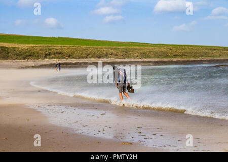 Northumberland, UK. 19th September, 2018. Storm Ali brings strong winds whipping up waves and sand on the Northumberland coast, at Low Newton by the Sea, Northumberland, UK. Credit: NBSN / Alamy Live News - Stock Image