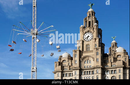 Fairground Ride In Front Of The Royal Liver Building, Liverpool. - Stock Image