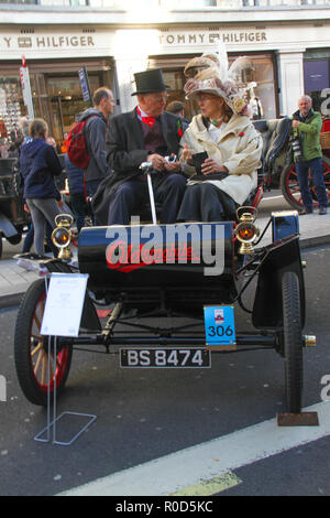 Regent Street, London 3 November 2018 - An elderly couple sit on their vintage Oldsmobile in Regent Street ahead of the Bonhams London to Brighton Veteran Car Run on 4 November. London's premier shopping destination was transformed into the country's biggest free-to-view motor show as Regent street was pedestrianised for the days event on 3 November. The show included electirc cars, to vintage and classic cars and attracted more than 500,000 visitors. Credit: David Mbiyu /Alamy Live News - Stock Image