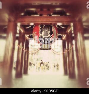 Giant lantern at the Daisanmon entrance of Kawasaki Daishi, a Buddhist shrine in Kawasaki, Japan. Vignette and vintage - Stock Image