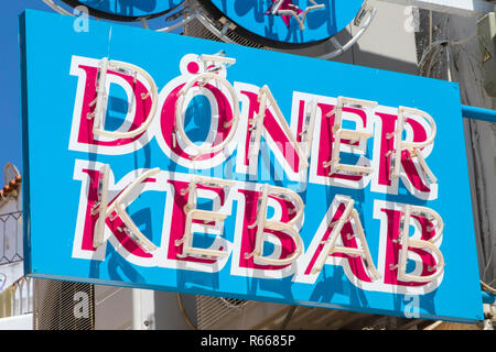 ALBUFEIRA, PORTUGAL - JULY 13TH 2018: A sign for a Doner Kebab takeaway shop in Europe, on 13th July 2018. - Stock Image