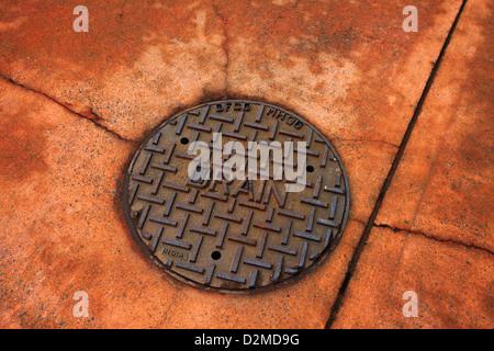 water drain on street - Stock Image
