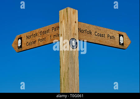 Wooden finger post sign against a blue sky - Stock Image