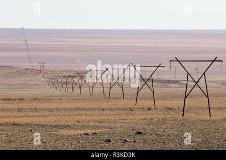 Africa, Namibia, Aus. Powerlines stretching across landscape. Credit as: Wendy Kaveney / Jaynes Gallery / DanitaDelimont.com - Stock Image
