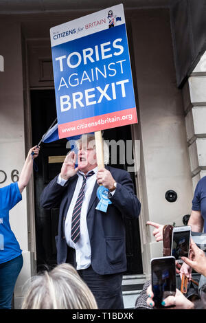 London, UK, 23rd March 2019. A million protestors march against Brexit and in support of a second referendum. A marcher looking like Boris Johnson - Stock Image